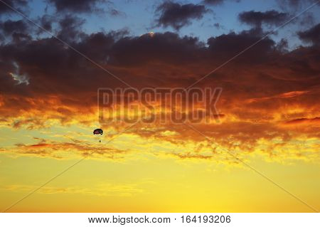 Para sailing on the background of beautiful sunset