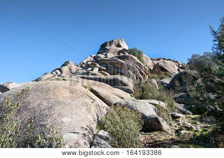 Views of La Pedriza, Madrid, Spain. It is a granite mountain where geological forces have create a remarkable boulder field of strangely eroded granite outcrops.