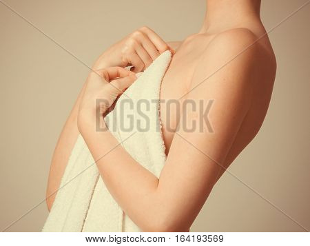Woman Covering Breast Under Towel.