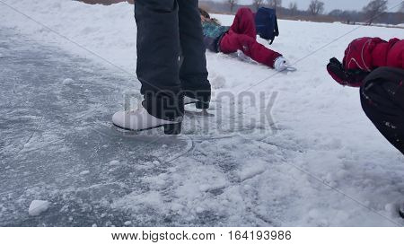 People skate on the skating sports rink in the winter on ice, active winter holiday family