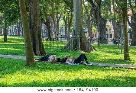 Siesta in the park at Hoan Kiem Lake in Hanoi, Vietnam