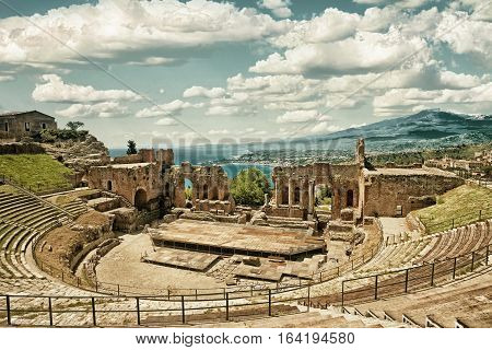 Greek theater in Taormina with the Etna volcano in the back in Sicily Italy (HDR image black gold filter)