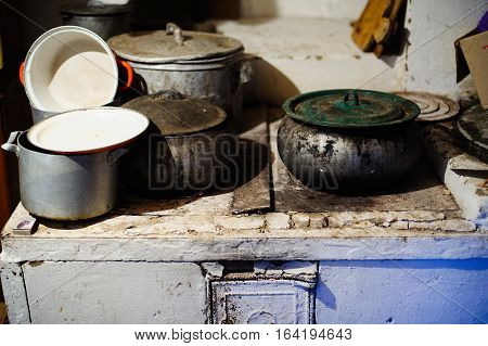 poverty Russian villages the old wood stove and utensils
