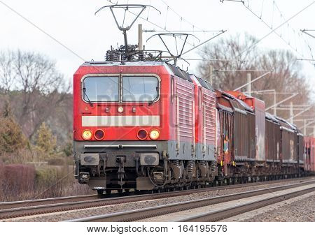 german cargo train drives on tracks to freight yard