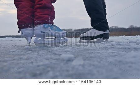 People skate on skating rink in the winter on ice, active sports winter holiday family