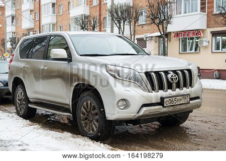 Moscow, Russia - December 01, 2016: Toyota Land Cruiser parked in winter on a dirty russian road.