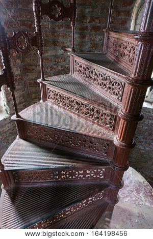 Old spiral forged iron staircase inside the lighthouse