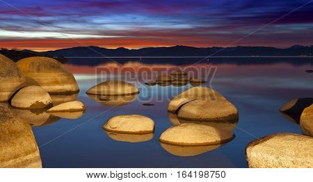 Lake Tahoe Sunset with granite boulders and shoreline