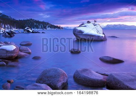 Bonsai Rock Sunset, Lake Tahoe, Nevada.  Bonsai rock is a large granite boulder with a small tree growing out of the top.