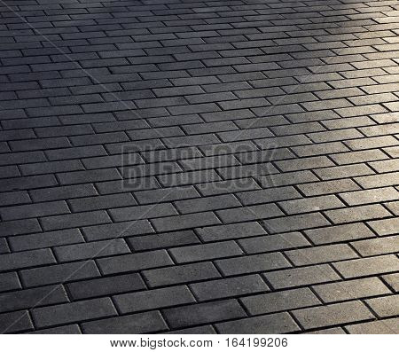 Tiles background photo with sun light hotspots
