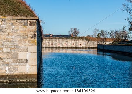 Fortress walls and moat of Fort Monroe National Monument in Hampton Virginia.
