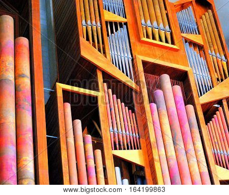 Church organ pipes displayed inside a place of worship.