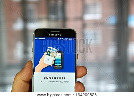 MONTREAL CANADA - DECEMBER 23 2016 : NFC payment android application on Samsung S7 screen.