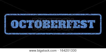 Blue rubber seal stamp with Octoberfest text. Vector tag inside rounded rectangular frame. Grunge design and scratched texture for watermark labels. Horisontal sign on a black background.