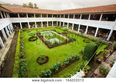KANDY, SRI LANKA. July 24, 2016: Market Hall in Kandy in Sri Lanka. Cloister garden. Quadrilateral-shaped cloister garden market on two floors in Kandy city, Sri Lanka. Wide angle perspective.