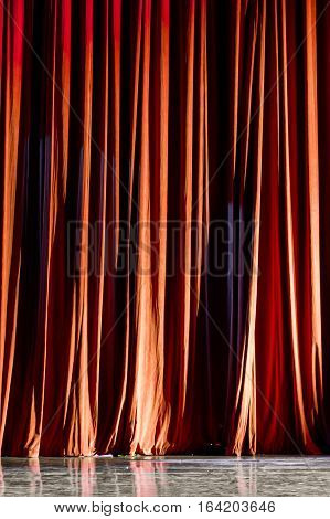 Vertical Red Curtain On The Stage.