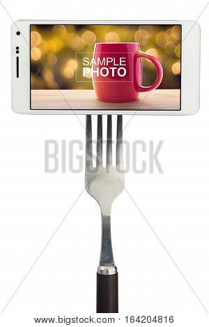 Spoon and fork with smartphone isolated on white background
