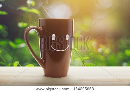 Brown coffee cup empty front porch the morning. Good morning or Have a happy day message concept