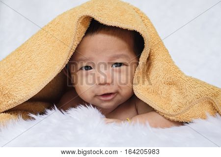 Two month infant asian baby boy on bed