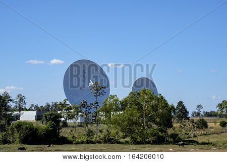 Large satellite dish radar antenna station with blue sky. Space Communication Center