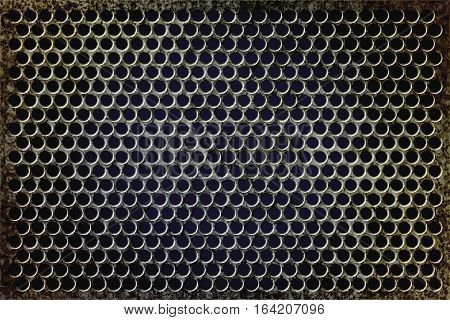 Grunge rusty perforated metal background. Macro photo