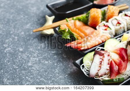 Sushi Set. Different sashimi sushi and rolls