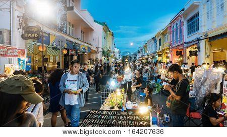 PHUKET THAILAND NOVEMBER 27: Tourists enjoy shopping at the walking street among old building Chino Portuguese style on street of Phuket town Thailand on November 27 2016.