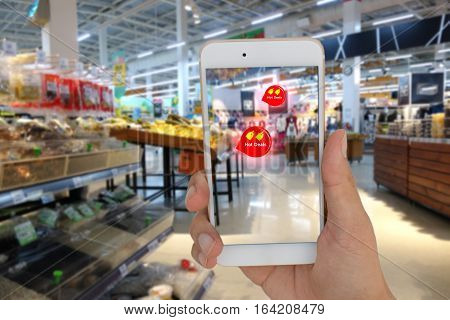 internet of things marketing concept ,the customer use the augmented reality to show the hot deal in the retail