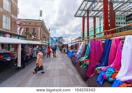 Eindhoven Netherlands - April 12 2016: street market in the city center with unidentified people. With about 225000 inhabitants its the 5th-largest municipality of Netherlands