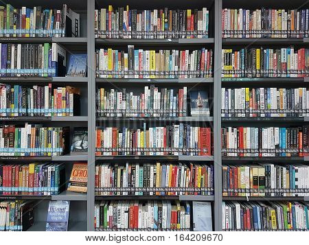 BANGKOK THAILAND - APRIL 29 2016: Modern Finance And Economics Book For Rent To Read On Library Shelf.
