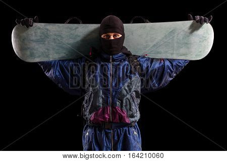 rider holding snowboard isolated on black background