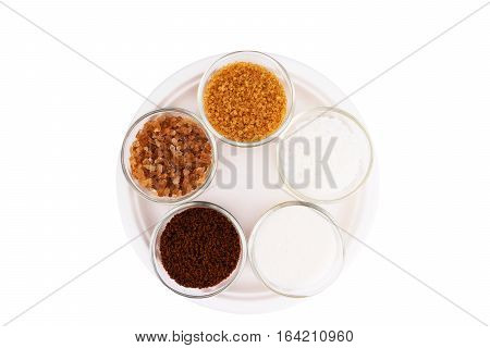various type of Sugar in the cups white pure cane brown dark brown soft golden caster for background