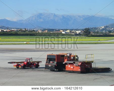Malaga Spain - December 19 2016: Utility vehicles on apron at Malaga Airport