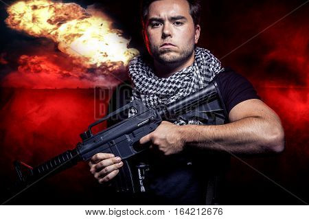 Soldier with a gun surviving bombs that are weapons of mass destruction or a nuclear war. The image depicts warfare and apocalyptic WW3.