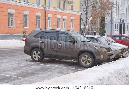 SARANSK, RUSSIA - JANUARY 6, 2017: KIA Sorento parked on city street. Photo taken at cloudy day.