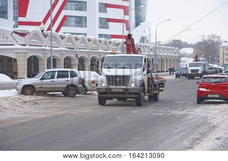 SARANSK, RUSSIA - JANUARY 6, 2017: GAZon Next tow truck at city street. Photo taken at cloudy day.