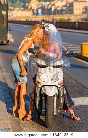 Florence Italy - July 04 2016: unidentified women with a scooter in Florence. Scooter are a very popular means of transport in Italy