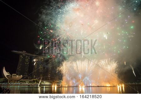 January 1 2017. A large fireworks show over Marina Bay commemorates the New Year. Esplanade Theater Singapore.