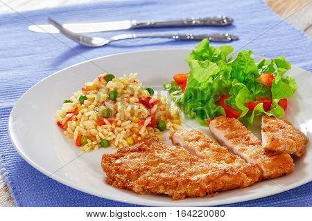 Fried In Batter Meat Chop With Colorful Risotto