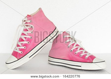 close up vintage style of sport pink gradient sneaker shoes on white background