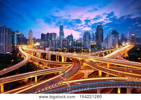 Shanghai elevated road junction and interchange overpass at night Shanghai China