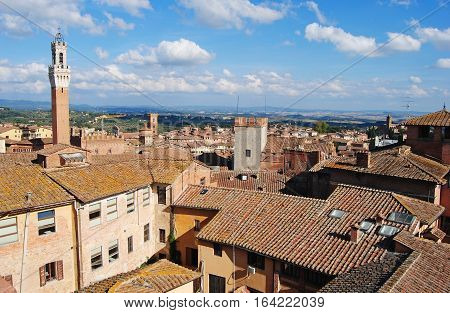 Siena, Italy - October 8, 2014. View over Siena, Italy with Palazzo Comunale on the left, with rooftops of historic buildings.