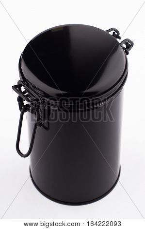 top view of black metal thin can container cylinder form for tea or coffee packaging isolated on white