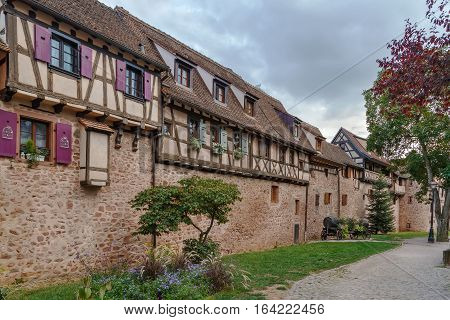 Houses in place of Riquewihr city wall Alsace France