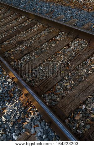 View of looking down on railroad tracks with leaves