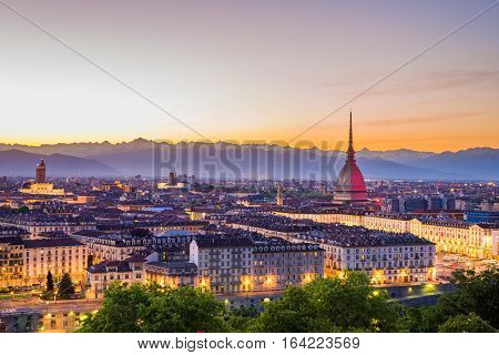 Cityscape of Torino (Turin Italy) at sunset with colorful clear sky. The Mole Antonelliana towering on the city.