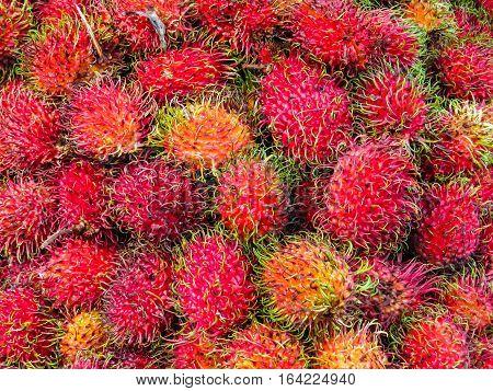 Rambutan, exotic fruit on the street market