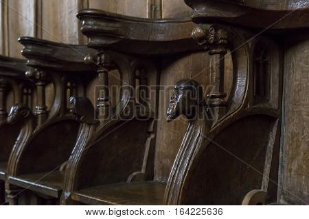 ROSKILDE, DENMARK - JUNE 26, 2016: There are carved wooden stalls in the presbytery of the cathedral in Roskilde.