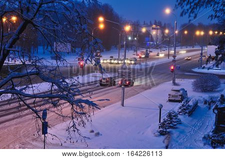 Top view to avenue covered with snow in early morning or evening. Winter snow disaster in a city. snowstorm on a road cars in snow. blue and yellow colors