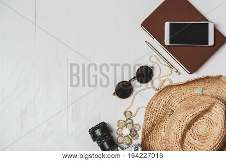 Female Travel Style Concept. Set Of Women's Accessories On White Wooden Table.